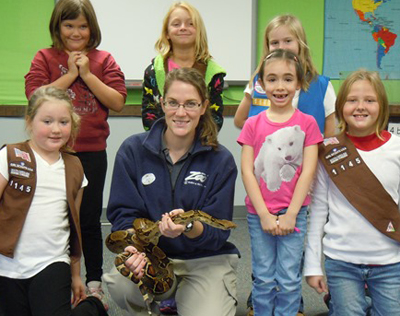 Zoo Employee and Girl Scout Troop Posing with a Snake